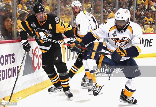 Evgeni Malkin of the Pittsburgh Penguins and PK Subban of the Nashville Predators play in the second period of Game One of the 2017 NHL Stanley Cup...