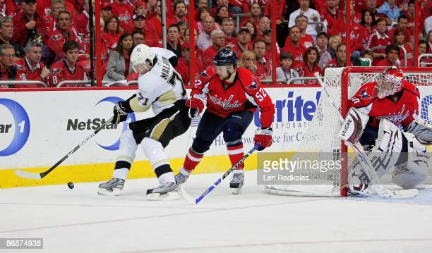 Evgeni Malkin of the Pittsburgh Penguins attempts a wrap around shot against Mike Green and Simeon Varlamov of the Washington Capitals during Game...