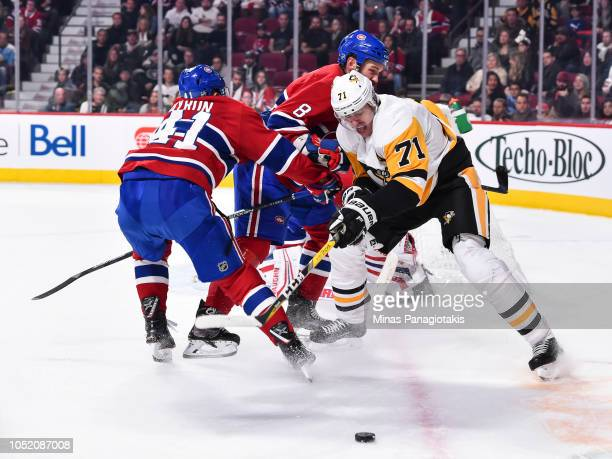 Evgeni Malkin of the Pittsburgh Penguins battles for the puck against Paul Byron of the Montreal Canadiens during the NHL game at the Bell Centre on...