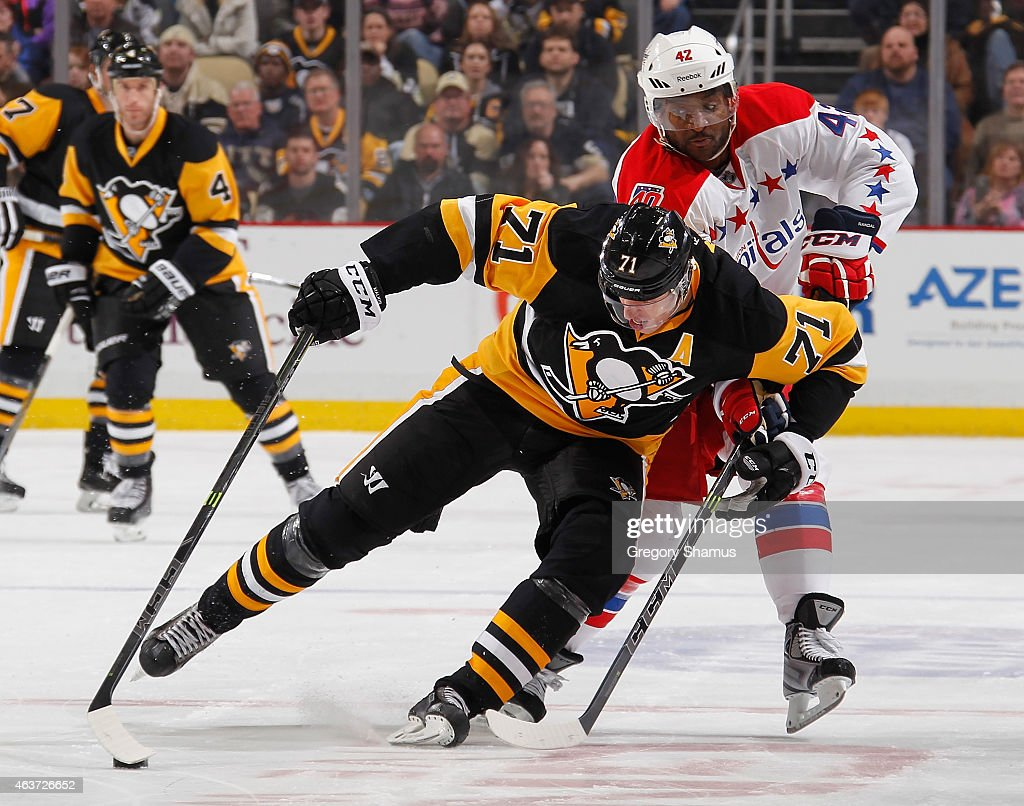 Evgeni Malkin #71 of the Pittsburgh Penguins battles for the puck against Joel Ward #42 of the Washington Capitals at Consol Energy Center on February 17, 2015 in Pittsburgh, Pennsylvania.