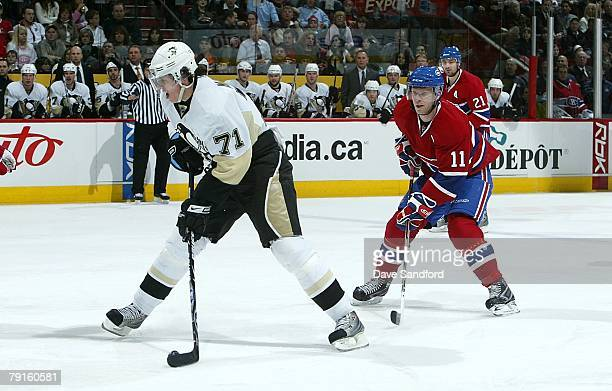 Evgeni Malkin of the Pittsburgh Penguins carries the puck as Saku Koivu the Montreal Canadiens backchecks during their NHL game at the Bell Centre...