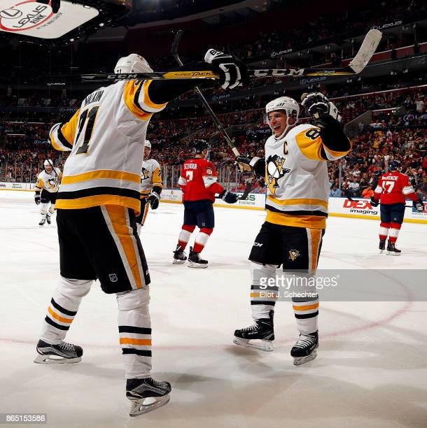 Evgeni Malkin of the Pittsburgh Penguins celebrates a goal with teammate Sidney Crosby against the Florida Panthers at the BBT Center on October 20...