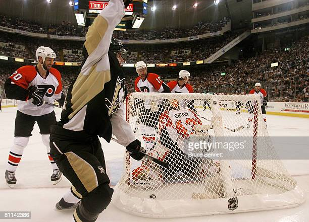 Evgeni Malkin of the Pittsburgh Penguins celebrates after scoring a goal at 950 of the first period as goaltender Martin Biron and RJ Umberger of the...