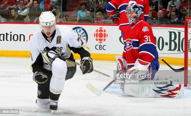 Evgeni Malkin of the Pittsburgh Penguins celebrates his 1st period goal as Carey Price of the Montreal Canadiens kneels in dejection during their NHL...