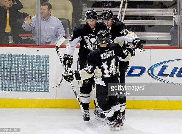 Evgeni Malkin of the Pittsburgh Penguins celebrates his first period goal with James Neal and Chris Kunitz against the Detroit Red Wings during the...