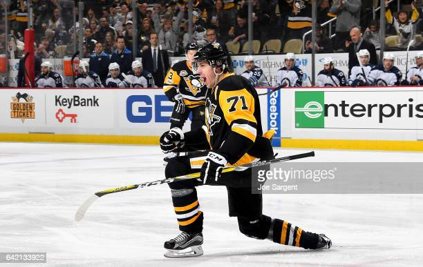 Evgeni Malkin of the Pittsburgh Penguins celebrates his first period goal against the Winnipeg Jets at PPG Paints Arena on February 16 2017 in...