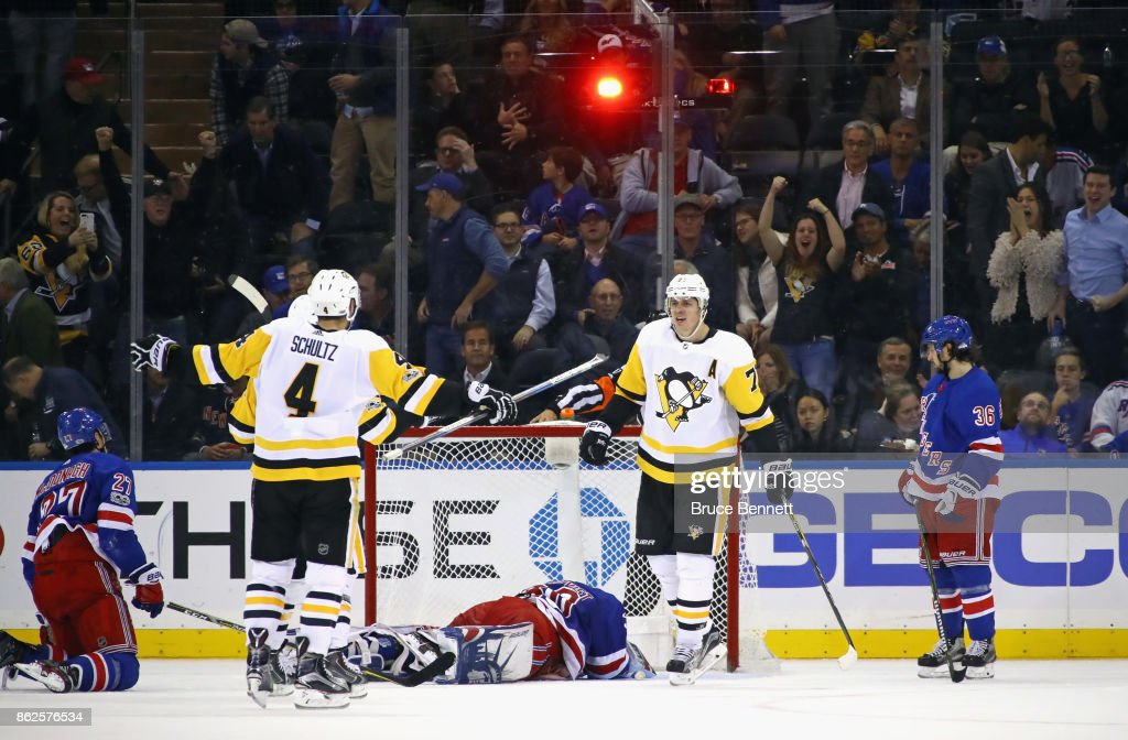 Evgeni Malkin #71 of the Pittsburgh Penguins celebrates his game winning goal at 58 seconds of overtime against Henrik Lundqvist #30 of the New York Rangers at Madison Square Garden on October 17, 2017 in New York City. The Penguins defeated the Rangers 5-4 in overtime.
