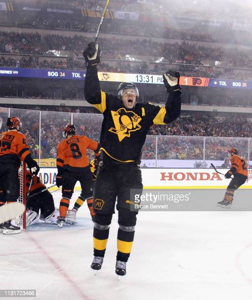 Evgeni Malkin of the Pittsburgh Penguins celebrates his goal at 629 of the third period against the Philadelphia Flyers during the 2019 Coors Light...