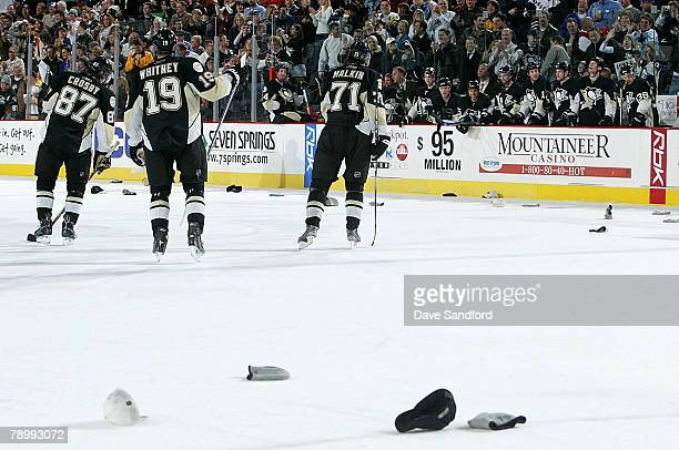 Evgeni Malkin of the Pittsburgh Penguins celebrates his hatrick goal against the New York Rangers with teammates Sidney Crosby Ryan Whitney and Colby...