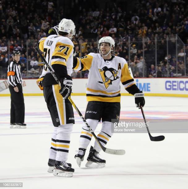 Evgeni Malkin of the Pittsburgh Penguins celebrates his powerplay goal at 1202 of the third period against the New York Islanders and is joined by...