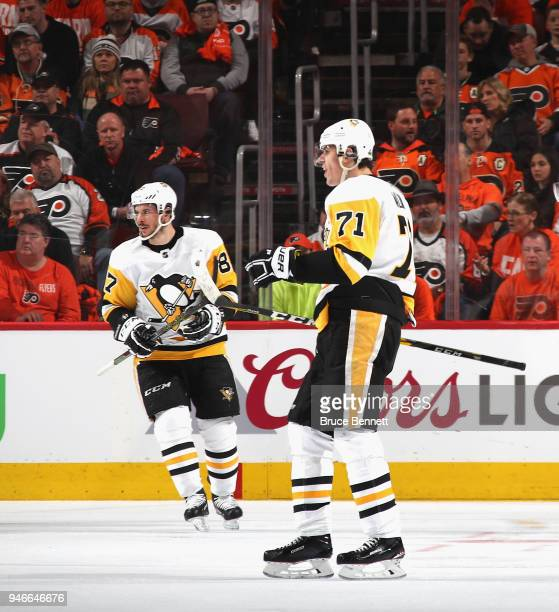 Evgeni Malkin of the Pittsburgh Penguins celebrates his powerplay goal at 648 of the second period against the Philadelphia Flyers and is joined by...