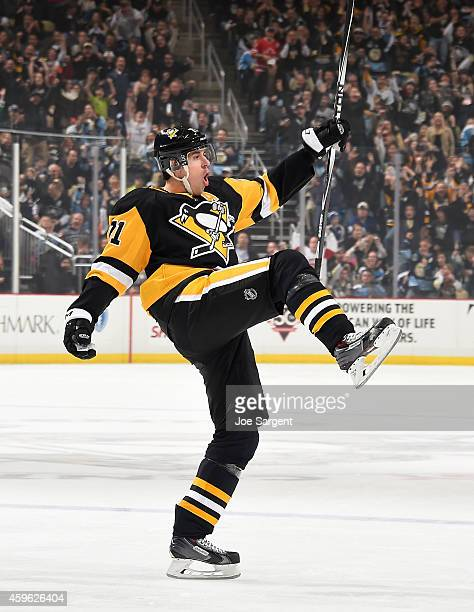Evgeni Malkin of the Pittsburgh Penguins celebrates his powerplay goal during the first period against the Toronto Maple Leafs at Consol Energy...
