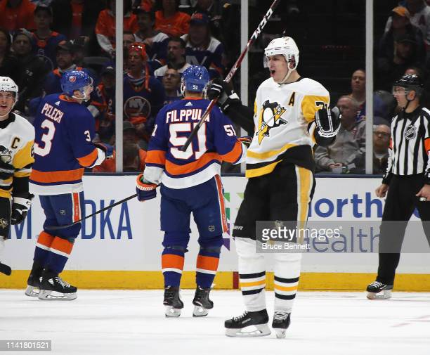 Evgeni Malkin of the Pittsburgh Penguins celebrates his second period goal against the New York Islanders in Game One of the Eastern Conference First...