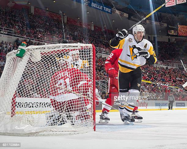 Evgeni Malkin of the Pittsburgh Penguins celebrates his second period goal on Jared Coreau of the Detroit Red Wings during an NHL game at Joe Louis...