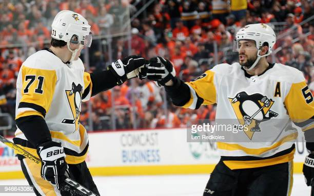 Evgeni Malkin of the Pittsburgh Penguins celebrates his second period powerplay goal against the Philadelphia Flyers with Kris Letang in Game Three...