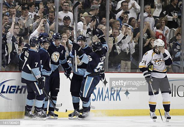 Evgeni Malkin of the Pittsburgh Penguins celebrates with his teammates Paul Martin Chris Kunitz James Neal and Kris Letang after scoring against the...