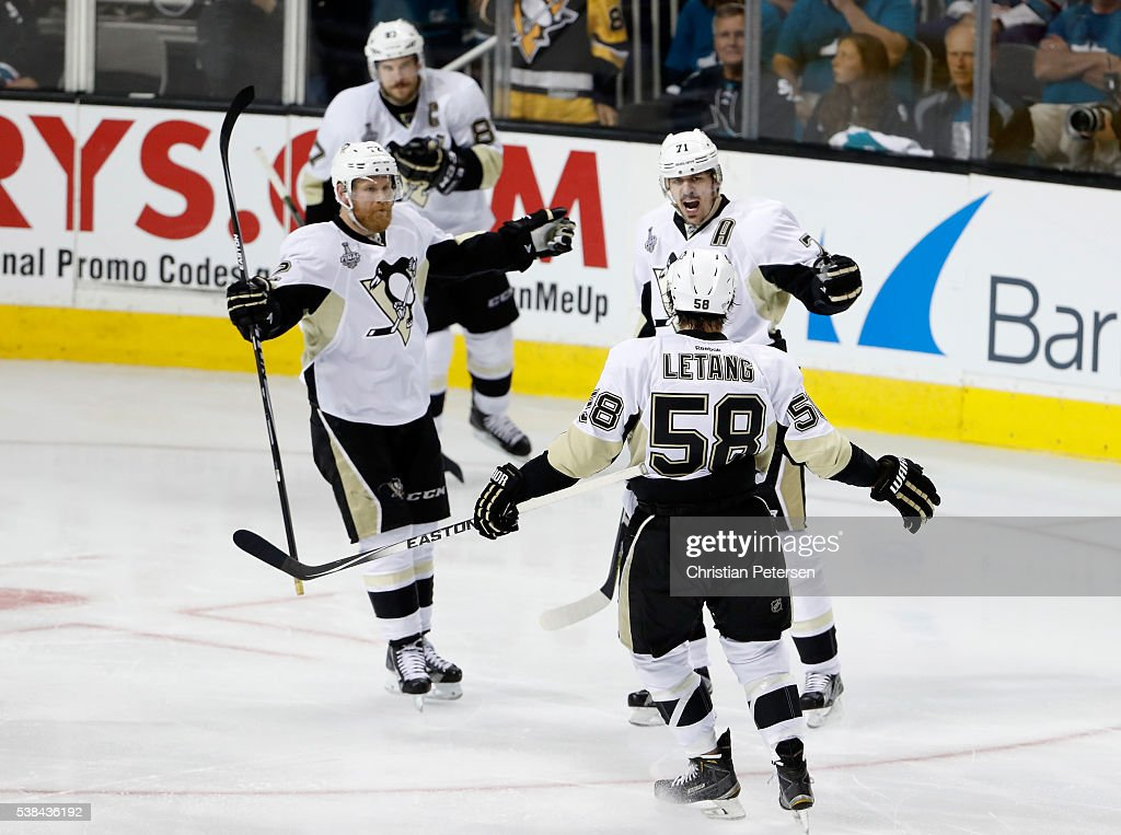 Evgeni Malkin #71 of the Pittsburgh Penguins celebrates with Patric Hornqvist #72 and Kris Letang #58 after scoring against the San Jose Sharks in the second period of Game Four of the 2016 NHL Stanley Cup Final at SAP Center on June 6, 2016 in San Jose, California.