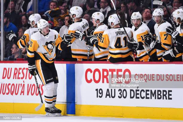Evgeni Malkin of the Pittsburgh Penguins celebrates with teammates on the bench against the Montreal Canadiens during the NHL game at the Bell Centre...