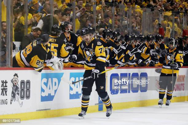 Evgeni Malkin of the Pittsburgh Penguins celebrates with teammates on the bench after scoring a goal during the third period in Game Two of the 2017...