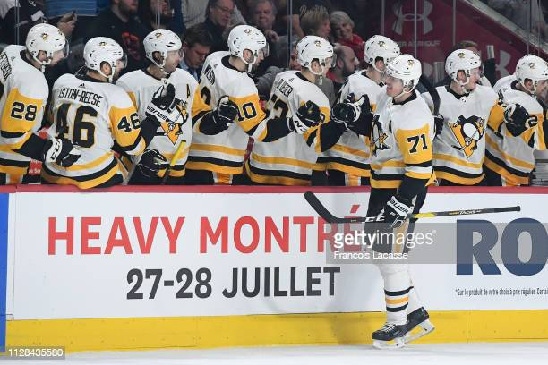 Evgeni Malkin of the Pittsburgh Penguins celebrates with the bench after scoring a goal against the Montreal Canadiens in the NHL game at the Bell...