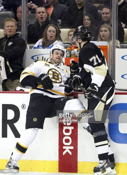 Evgeni Malkin of the Pittsburgh Penguins checks Daniel Paille of the Boston Bruins during the game at Consol Energy Center on October 30 2013 in...
