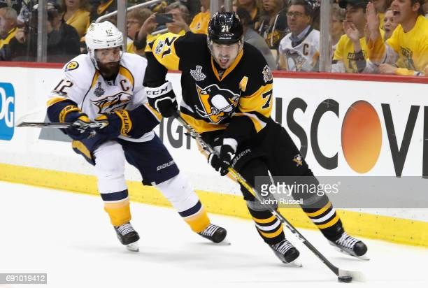 Evgeni Malkin of the Pittsburgh Penguins controls the pcuk away fromMike Fisher of the Nashville Predators during the third period of Game Two of the...
