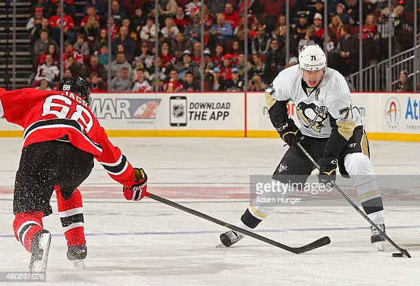 Evgeni Malkin of the Pittsburgh Penguins controls the puck against Jaromir Jagr of the New Jersey Devils during the first period at the Prudential...