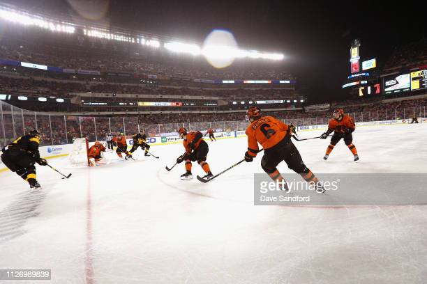 Evgeni Malkin of the Pittsburgh Penguins controls the puck behind the net during the 2019 Coors Light NHL Stadium Series game between the Pittsburgh...