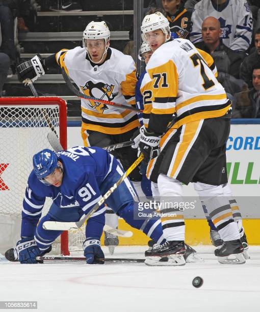 Evgeni Malkin of the Pittsburgh Penguins covers John Tavares of the Toronto Maple Leafs during an NHL game at Scotiabank Arena on October 18 2018 in...