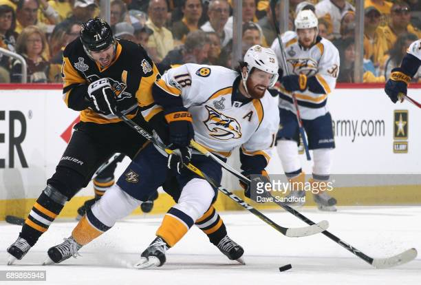 Evgeni Malkin of the Pittsburgh Penguins defends James Neal of the Nashville Predators during the first period of Game One of the 2017 NHL Stanley...