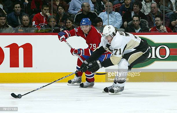 Evgeni Malkin of the Pittsburgh Penguins drives to the net past Andrei Markov of the Montreal Canadiens during their NHL game at the Bell Centre...