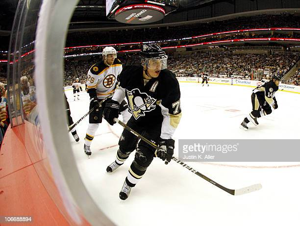 Evgeni Malkin of the Pittsburgh Penguins eyes the puck in the corner against the Boston Bruins at Consol Energy Center on November 10 2010 in...