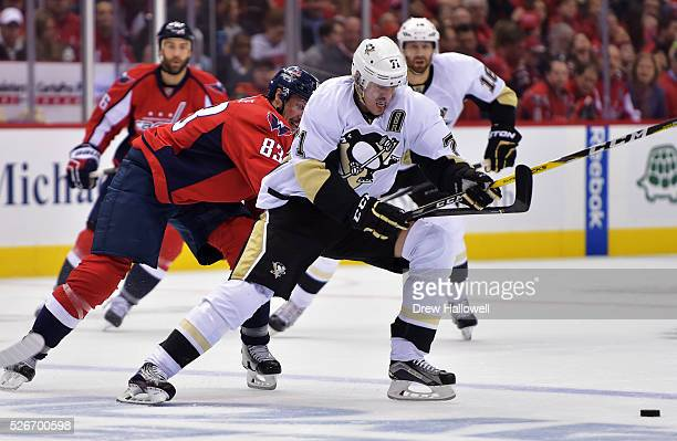 Evgeni Malkin of the Pittsburgh Penguins fights off Jay Beagle of the Washington Capitals during Game Two of the Eastern Conference Second Round...