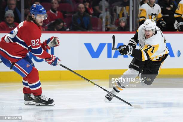 Evgeni Malkin of the Pittsburgh Penguins fires a shot against the Montreal Canadiens in the NHL game at the Bell Centre on March 2, 2019 in Montreal,...