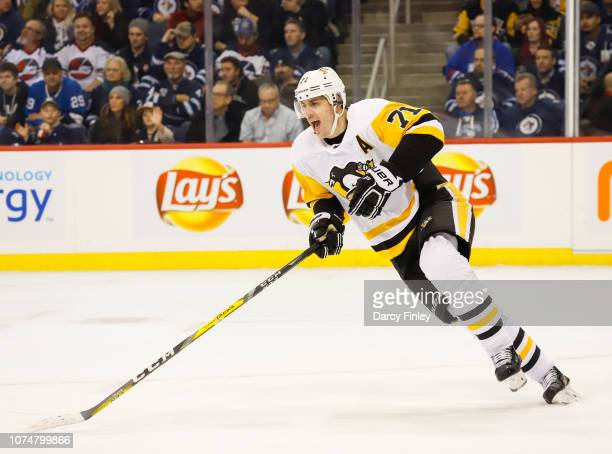 Evgeni Malkin of the Pittsburgh Penguins follows the play up the ice during first period action against the Winnipeg Jets at the Bell MTS Place on...