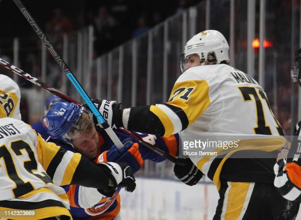 Evgeni Malkin of the Pittsburgh Penguins get a first period call for high sticking Leo Komarov of the New York Islanders in Game Two of the Eastern...