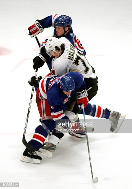 Evgeni Malkin of the Pittsburgh Penguins gets tangled between Marc Staal and Michal Rozsival of the New York Rangers during the third period of Game...