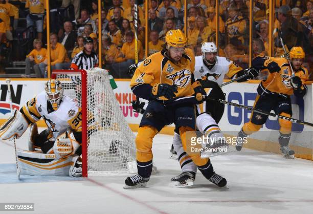 Evgeni Malkin of the Pittsburgh Penguins goes down on a check by Filip Forsberg of the Nashville Predators during the third period of Game Four of...