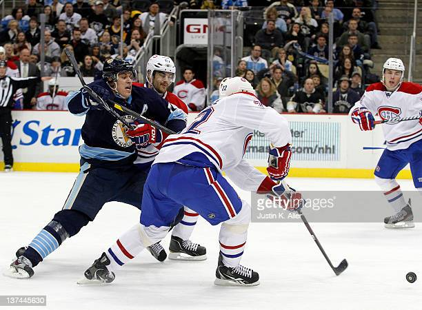 Evgeni Malkin of the Pittsburgh Penguins handles the puck against Tomas Kaberle of the Montreal Canadiens during the game at Consol Energy Center on...