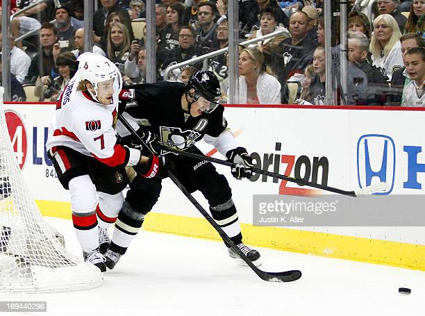 Evgeni Malkin of the Pittsburgh Penguins handles the puck against Kyle Turris of the Ottawa Senators in Game Five of the Eastern Conference...