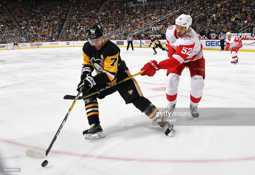 Evgeni Malkin #71 of the Pittsburgh Penguins handles the puck against Jonathan Ericsson #52 of the Detroit Red Wings at PPG Paints Arena on January 13, 2018 in Pittsburgh, Pennsylvania.