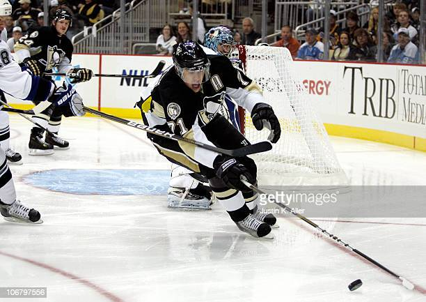 Evgeni Malkin of the Pittsburgh Penguins handles the puck against the Tampa Bay Lightning at Consol Energy Center on November 12 2010 in Pittsburgh...