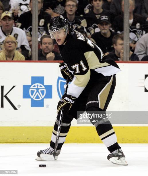 Evgeni Malkin of the Pittsburgh Penguins handles the puck against the Boston Bruins at Mellon Arena on March 7 2010 in Pittsburgh Pennsylvania The...