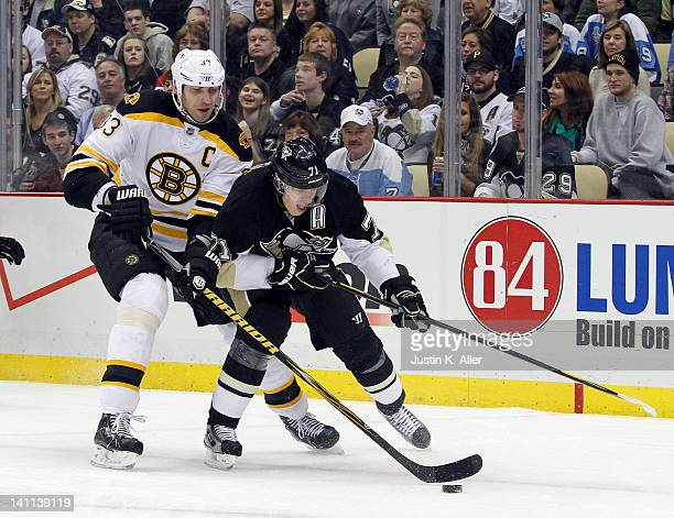 Evgeni Malkin of the Pittsburgh Penguins handles the puck in front of Zdeno Chara of the Boston Bruins during the game at Consol Energy Center on...