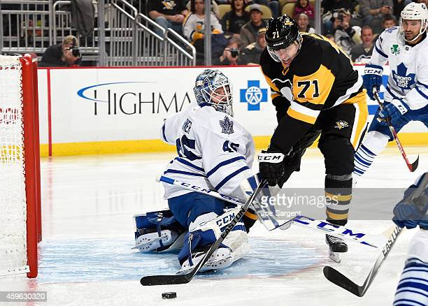 Evgeni Malkin of the Pittsburgh Penguins has his shot blocked by Jonathan Bernier of the Toronto Maple Leafs at Consol Energy Center on November 26...