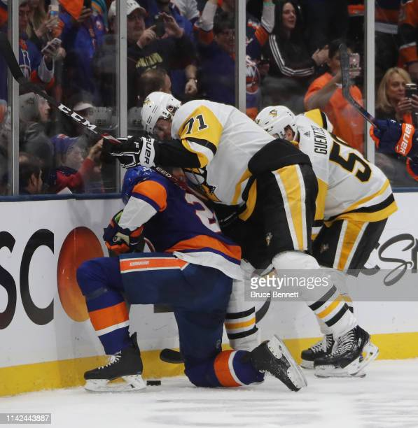 Evgeni Malkin of the Pittsburgh Penguins hits Brock Nelson of the New York Islanders at the end of their game in Game Two of the Eastern Conference...