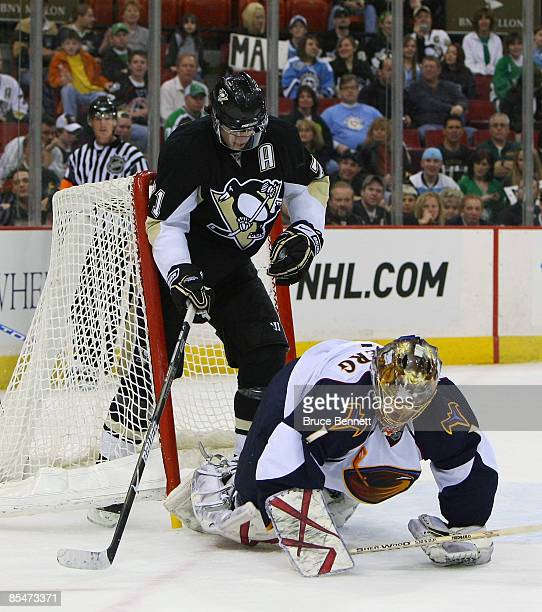Evgeni Malkin of the Pittsburgh Penguins is backed into by Johan Hedberg of the Atlanta Thrashers at the Mellon Arena March 17 2009 in Pittsburgh...