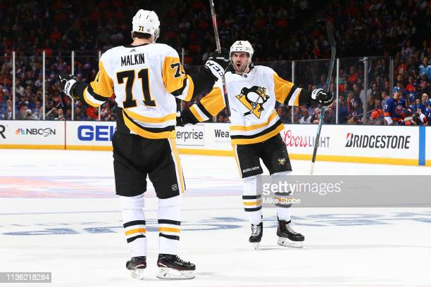 Evgeni Malkin of the Pittsburgh Penguins is congratulated by his teammate Justin Schultz after scoring a second period goal against the New York...