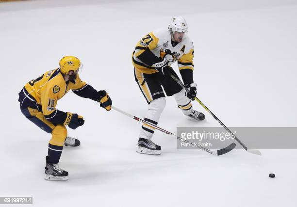 Evgeni Malkin of the Pittsburgh Penguins is defended by Mattias Ekholm of the Nashville Predators during the second period in Game Six of the 2017...