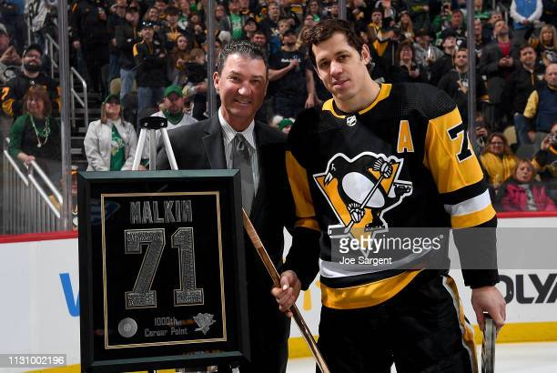 Evgeni Malkin of the Pittsburgh Penguins is honored for his 1000 NHL points by Mario Lemieux before the game against the St Louis Blues at PPG Paints...